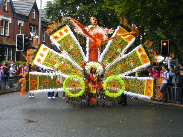 Red Indian head dress costume, Leeds Carnival 2015. Photo by Mick Burton continuous line artist.