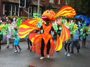Yellow and orange costume which lit up the parade at the Leeds Carnival. Photo by Mick Burton, continuous line artist.
