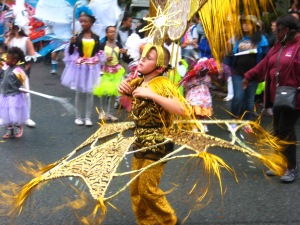 Gold costume at the Leeds Carnival. Photo by Mick Burton, continuous line artist.