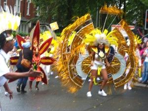 Catherine wheel costume at Leeds Carnival. Photo Mick Burton, continuous line artist.