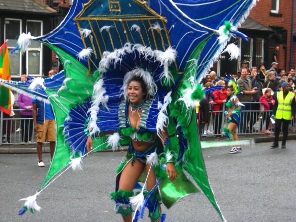 Blue and Green costume at Leeds Carnival. Photo Mick Burton, continuous line artist.