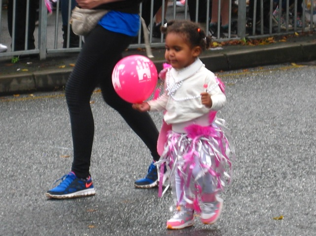Child with balloon in Leeds Carnival parade. Photo Mick Burton, continuous line artist.