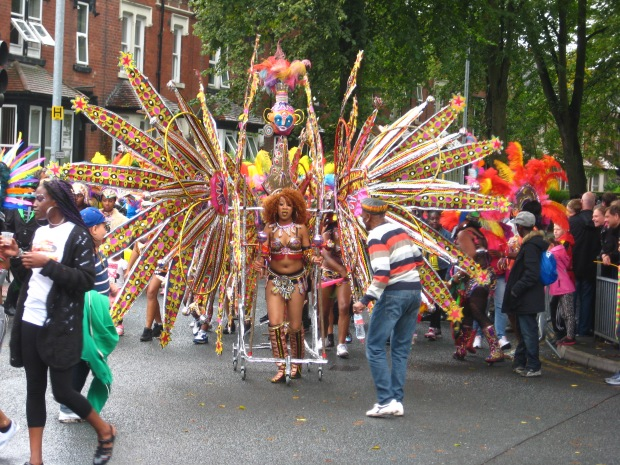 Multi petal costume at Leeds Carnival parade. Photo Mick Burton, continuous line artist.