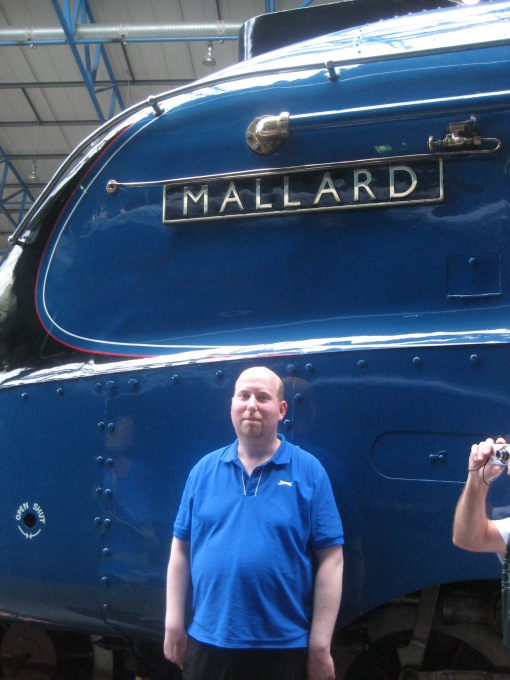 Mallard, the fastest ever steam engine, at York National Railway Museum along with my son Matthew. Photo Mick Burton, continuous line artist.